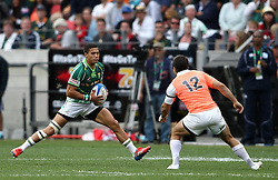 Cheslin Kolbe of South Africa attempts to get past Diego Palma of Argentina during the Cup Semi Final between South Africa and Argentina on Day 2 of the HSBC Sevens World Series Port Elizabeth Leg held at the Nelson Mandela Bay Stadium on 8th December 2013 in Port Elizabeth, South Africa. Photo by Shaun Roy/Sportzpics