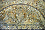 Tympanum of the south door of the 12the century  church of St Peter & St Paul depicting Chirst in Majest, Pantocrator, with flying angels each side holding up the Mandorla or aureol he is sitting in. This is very typical of Eastern Roman or Byzantine art and the geometric designs suggest this is Norman art of the 12th century rebuilding  of Malmesbury Abbey, Wiltshire, England .<br /> <br /> Visit our MEDIEVAL PHOTO COLLECTIONS for more   photos  to download or buy as prints https://funkystock.photoshelter.com/gallery-collection/Medieval-Middle-Ages-Historic-Places-Arcaeological-Sites-Pictures-Images-of/C0000B5ZA54_WD0s