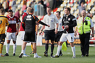 Northampton manager Chris Wilder (third left) confronts the referee Christopher Sarginson at the end of the match.  Skybet football league two match, Newport county v Northampton Town at Rodney Parade in Newport, South Wales on Saturday13th Sept 2014<br /> pic by Mark Hawkins, Andrew Orchard sports photography.