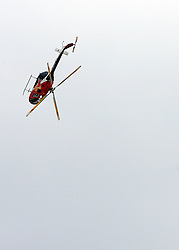 Acrobatic Heli of Red Bull at Flying Hill Team in 3rd day of 32nd World Cup Competition of FIS World Cup Ski Jumping Final in Planica, Slovenia, on March 21, 2009. (Photo by Vid Ponikvar / Sportida)