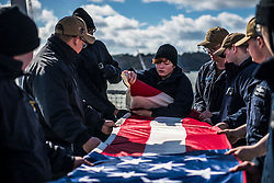 190317-N-KA046-0152<br /> <br /> PLYMOUTH, England (March 17, 2019) Sailors fold an American flag aboard the Arleigh Burke-class guided-missile destroyer USS Porter (DDG 78) while departing Plymouth, England, March 17, 2019. Porter, forward-deployed to Rota, Spain, is on its sixth patrol in the U.S. 6th Fleet area of operations in support of U.S national security interests in Europe and Africa. (U.S. Navy photo by Mass Communication Specialist 2nd Class James R. Turner/Released)