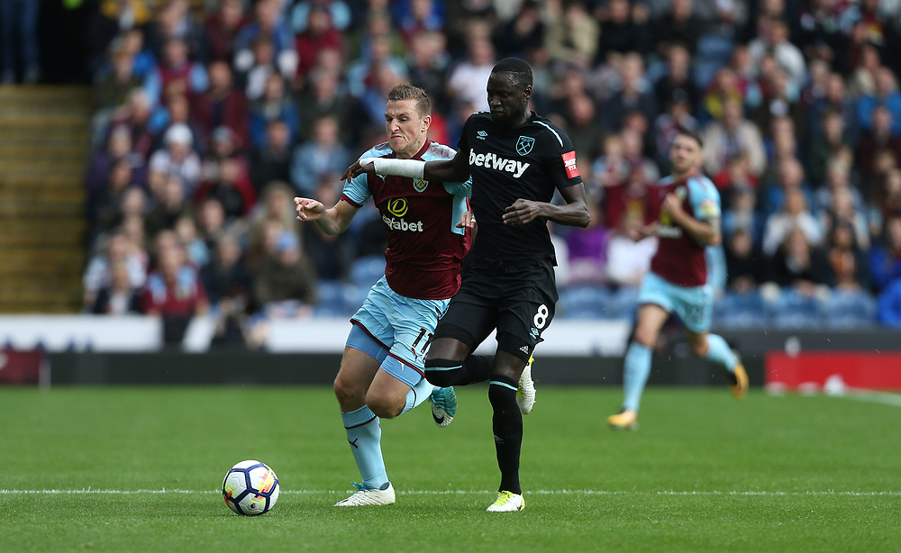 Burnley's Chris Wood and West Ham United's Cheikhou Kouyate<br /> <br /> Photographer Rob Newell/CameraSport<br /> <br /> The Premier League - Burnley v West Ham United - Saturday 14th October 2017 - Turf Moor - Burnley<br /> <br /> World Copyright © 2017 CameraSport. All rights reserved. 43 Linden Ave. Countesthorpe. Leicester. England. LE8 5PG - Tel: +44 (0) 116 277 4147 - admin@camerasport.com - www.camerasport.com