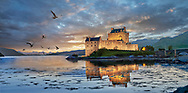 Towering Delusions  Eilean Donan Castle is on a small island in  Kyle of Lochalsh loch, Scotland. Photagraphed at sunset in its atmospheric setting backed by the Scotish mountains. By Paul Williams