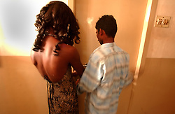 """Transgender sex worker enters a hotel room with her client in Villupuram, India. As transgenders,""""hijras"""" in local terms, are acutely marginalized in Indian society, the major earning avenues for them are sex work, begging and performing at rituals."""