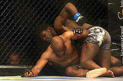 Regis Muyambo (Blue) punches Pope Djembo (Red) during the third bout of the Extreme Fighting Championships, EFC 52 held at the Grand West Casino in Cape Town, South Africa on the 5th August 2016<br /> <br /> Photo by:   Shaun Roy / Real Time Images