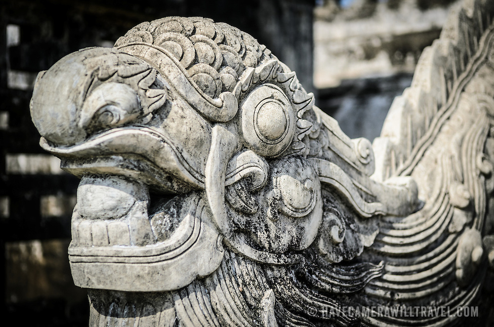 A stone dragon at the Imperial City in Hue, Vietnam. A self-enclosed and fortified palace, the complex includes the Purple Forbidden City, which was the inner sanctum of the imperial household, as well as temples, courtyards, gardens, and other buildings. Much of the Imperial City was damaged or destroyed during the Vietnam War. It is now designated as a UNESCO World Heritage site.