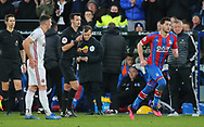 Referee Andy Madley changes his initial decision of a red card for Crystal Palace's Joel Ward to a yellow card during the Premier League match at Selhurst Park, London. Picture date: 1st February 2020. Picture credit should read: Paul Terry/Sportimage