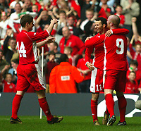 Photo: Scott Heavey<br />Wales V Azerbaijan. 29/03/03.<br />Ryan Giggs celebrates his first and Wales' fourth with John Hartson (right) and Carl Robinson (left) during this afternoons Euro 2004 Group 9 qualifying match at the Millenium stadium in Cardiff.