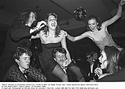 Tamara Yeardye on Alexander Kasterine, Cordelia Hart on Paddy Turner and  Cathy Kasterine above Charlotte Holt at the Bobbin Ball. Empire Rooms, 21 December 1983. © Copyright Photograph by Dafydd Jones 66 Stockwell Park Rd. London SW9 0DA Tel 020 7733 0108 www.dafjones.com