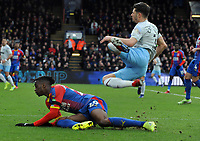 Football - 2018 / 2019 Premier League - Crystal Palace vs. West Ham United<br /> <br /> Aaron Wan - Bissaka of Palace fouls Aaron Cresswell with a high tackle on his ankle, at Selhurst Park.<br /> <br /> COLORSPORT/ANDREW COWIE