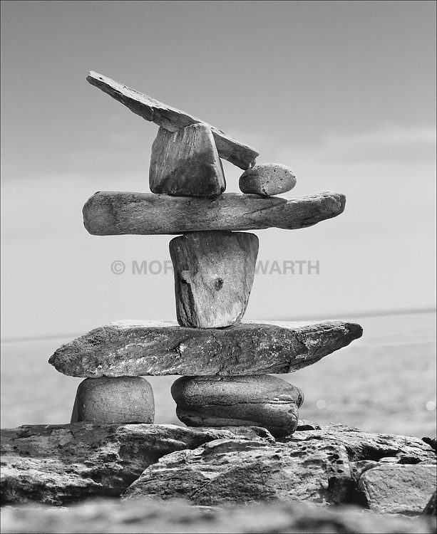 Rock Cairn Maine coast Beach rocks and stones formed by surf Maine rocky coast