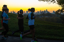 London, October 27 2017. A group of runners cross the skyline as the day breaks over London, seen from Primrose Hill. © Paul Davey