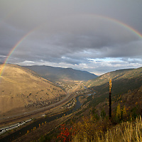 A rainbow spans Hellgate Canyon during a late-afternoon September rain east of Missoula.