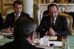 French President, Francois Hollande flanked by Emmanuel Macron receives European central bank President, Mario Draghi prior to a meeting at the Elysee presidential palace, in Paris, on May 27, 2013. Photo by Stephane Lemouton/ABACAPRESS.COM