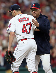 October 5, 2017 - Cleveland, OH, UKR - Cleveland Indians manager Tito Francona gives pitcher Trevor Bauer a pat on the back as he leaves the game in the seventh inning against the New York Yankees in Game 1 of the American League Division Series on Thursday, Oct. 5, 2017, at Progressive Field in Cleveland. (Credit Image: © Phil Masturzo/TNS via ZUMA Wire)