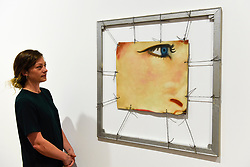 "© Licensed to London News Pictures. 10/09/2019. LONDON, UK. A staff member views ""Bedspring"", 1962, at a preview of ""Visualising the Sixties"", the first in depth exhibition of works by artist James Rosenquist.  From a painter of commercial billboards in New York City, to a fine art career as a Pop artist, Rosenquist's work was described as Andy Warhol's favourite.  The exhibition is on at Galerie Thaddaeus Ropac in Mayfair 10 September to 9 November.  Photo credit: Stephen Chung/LNP"
