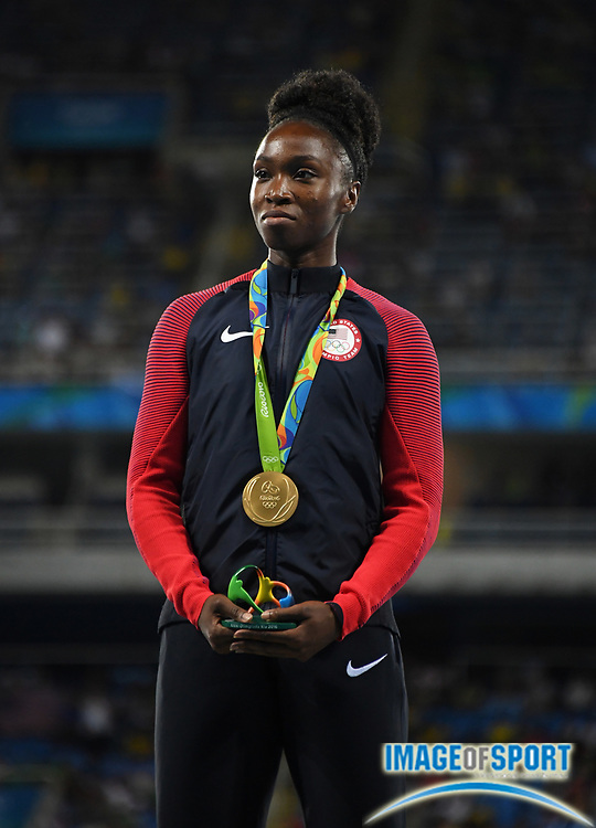 Aug 18, 2016; Rio de Janeiro, Brazil; Tianna Bartoletta (USA) poses with gold medal after winning the women's long jump during the 2016 Rio Olympics at Estadio Olimpico Joao Havelange.