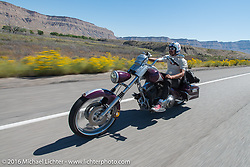 Bean're rides along doing his video interviews during stage 11 (289 miles) of the Motorcycle Cannonball Cross-Country Endurance Run, which on this day ran from Grand Junction, CO to Springville, UT., USA. Tuesday, September 16, 2014.  Photography ©2014 Michael Lichter.