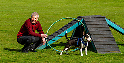Pictured: <br />Scottish Liberal Democrat Leader Willie Rennie headed to Edinburgh's Cat and Dog home today for a tour before criticising the SNP 's record in Government. Daisy the English Bull Terrier took Mr Rennie for some exercise<br />Ger Harley   EEm 23 April 2021