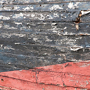 Detail of an old wooden fishing boat at the Essex Shipbuilding Museum, Essex, Massachsuetts