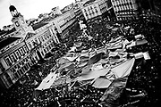 Spaniards flood Madrid's Puerta del Sol Square on regional and municipal pre-elections demonstrations. The general assembly of Sol was born after a protest in May 15 2011, organised via Twitter, Facebook and other social network. In the first meeting it was agreed to peacefully overnight in Puerta Del Sol. Suddenly, start the first working groups and the movement went to other places, gathering in central squares all over the country. They protest against high unemployment and politicians they consider inept. The aim was to claim a new society to give priority to people over the economic and political interests. A change in the society. Since then more and more citizens are actively involved in this community. They have decided to go on camping until the next Sunday, May 29 at least. # Photo Alberto Paredes / 4See