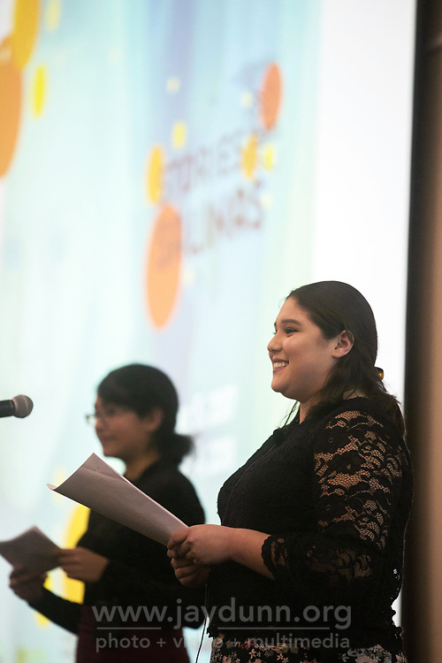 Krystal Herrera of Artists Ink, right, and Mariluz Tejeda of Youth for Change welcome the audience at the December 5th, 2017 opening of the Stories from Salinas exhibition at the CSUMB Salinas Center for Arts and Culture in Oldtown. The exhibition celebrates the mentors, youth and families of the Salinas Youth Initiative.