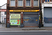 Old shop named Bargain Basement with its shutters down and closed for the forseeable future in Digbeth near the city ccentre on 18th January 2020 in Birmingham, United Kingdom.