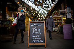 © Licensed to London News Pictures. 26/11/2020. London, UK. A sign at Borough Market in London informing people that hot food must be taken away and consumed offsite as a result of lockdown rules. The government has announced that London will be in Tier 2 when tiered restrictions are reintroduced once the England-wide lockdown ends on 2 December. Photo credit: Rob Pinney/LNP
