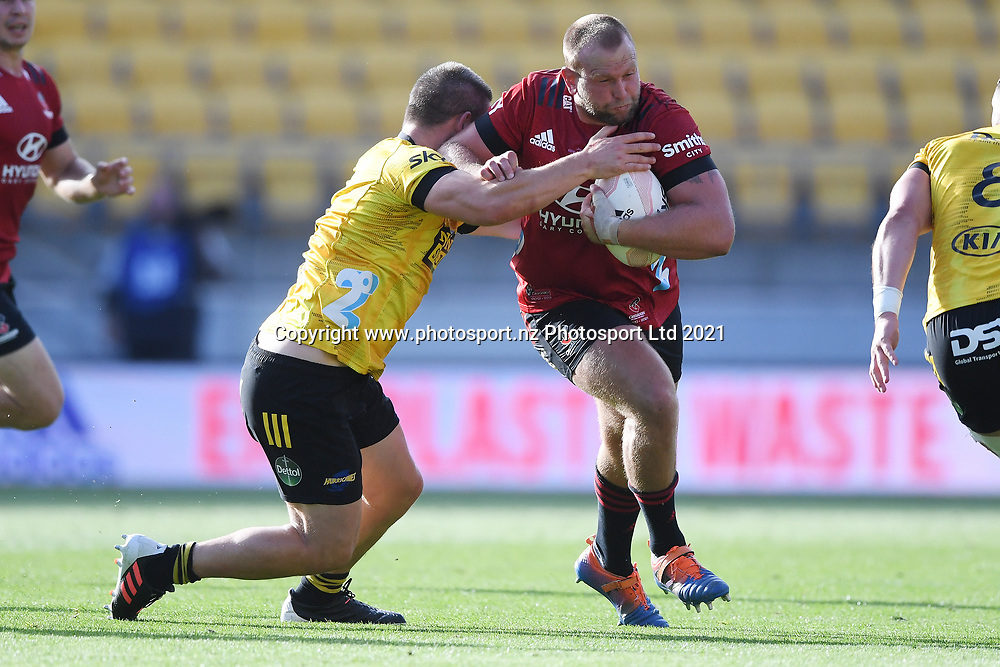 Crusaders Joe Moody is tackled in the Super Rugby match, Hurricanes v Crusaders, Sky Stadium, Wellington, Sunday, April 11, 2021. Copyright photo: Kerry Marshall / www.photosport.nz