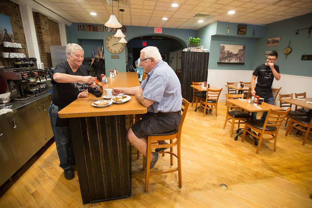 RUTHERFORD, NJ - JULY 25, 2015  Ingrid Dedijer serves coffee to Mauro Gagliardi as he eats breakfast at the Rutherford Pancake House in Rutherford. <br /> The Rutherford Pancake House in located on Park Avenue near Ames Avenue in Rutherford. <br /> CREDIT: John O'Boyle for The New York Times