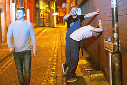 © Licensed to London News Pictures . 27/12/2016 . Wigan , UK . A man vomits against a wall on a side street . Revellers in Wigan enjoy Boxing Day drinks and clubbing in Wigan Wallgate . In recent years a tradition has been established in which people go out wearing fancy-dress costumes on Boxing Day night . Photo credit : Joel Goodman/LNP