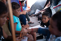 Children play in the El Chapparal camp of asylum seekers in Tijuana, Mexico.