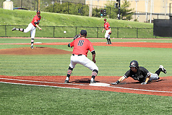 17 April 2016:  Will Farmer retreats to 1st base as David Meade delivers a put out throw attempt to Derek Parola during an NCAA Division I Baseball game between the Southern Illinois Salukis and the Illinois State Redbirds in Duffy Bass Field, Normal IL