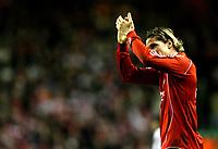 Photo: Paul Greenwood/Sportsbeat Images.<br />Liverpool v Porto. UEFA Champions League. 28/11/2007.<br />Liverpool's Fernando Torres applauds the Kop