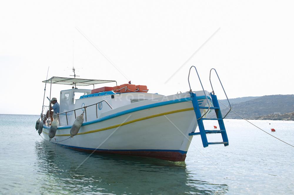 boat docked in the Aegean Sea in Mykonos, Greece