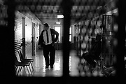 Captain John Murphy takes care of a situation in one of the cells of the inmates serving time.  The Bristol County Jail & House of Correction located on Ash Street in New Bedford, Massachusetts was started in 1829, and is the oldest running jail in the United States.   The Ash street jail, as it is known, has been a controversial facility since it opened.  It is believed to be the site of the last pubic hanging in Massachusetts sometime in the 1890's.  Two big riots broke out in the 90's (1993, 1998) and since then the facility has been modified to alleviate some of the crowded conditions that resulted in the riots.