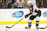 DALLAS, TX - SEPTEMBER 26:  Jamie McGinn #11 of the Colorado Avalanche controls the puck against the Dallas Stars in an NHL preseason game on September 26, 2013 at the American Airlines Center in Dallas, Texas.  (Photo by Cooper Neill/Getty Images) *** Local Caption *** Jamie McGinn