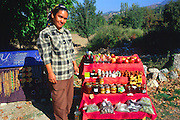 Woman selling items to tourists from a stall at Tlos, Turkey