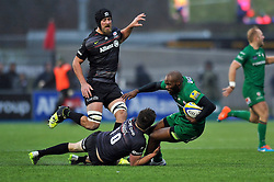 Topsy Ojo of London Irish is tackled to ground by Owen Farrell of Saracens - Photo mandatory by-line: Patrick Khachfe/JMP - Mobile: 07966 386802 03/01/2015 - SPORT - RUGBY UNION - London - Allianz Park - Saracens v London Irish - Aviva Premiership