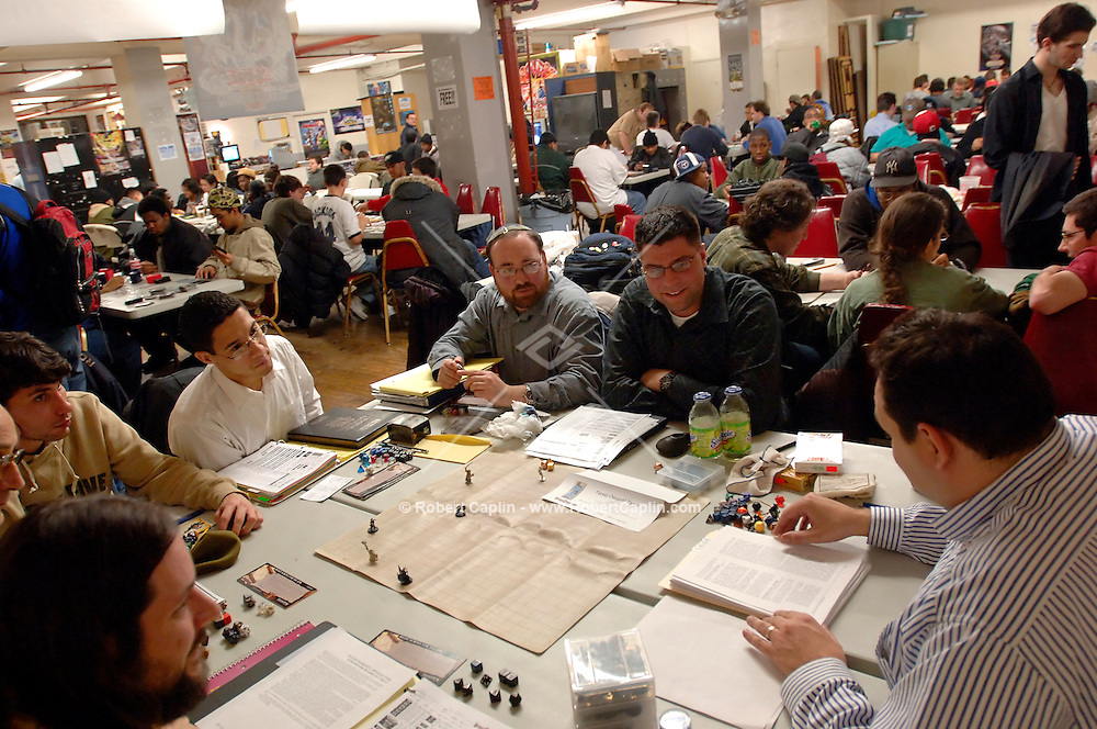A Dungeons and Dragons games take place at multiple tables at Neutral Ground in Manhattan Thursday Feb. 23, 2006. (Robert Caplin For The New York Times)..