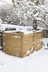 Wooden compost bins in snow