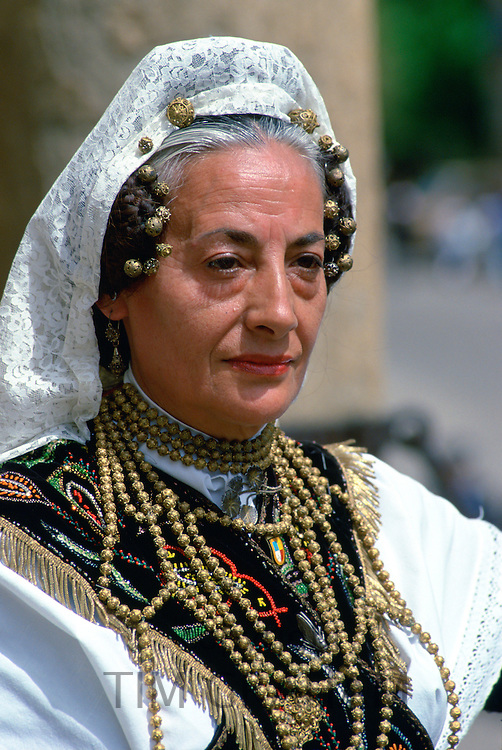Dancer in national dress wearing lace mantilla and gold beads in Salamanca, Spain