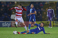 AFC Wimbledon attacker Shane McLoughlin (19) performing a sliding tackle during the The FA Cup match between AFC Wimbledon and Doncaster Rovers at the Cherry Red Records Stadium, Kingston, England on 9 November 2019.