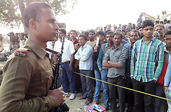 November 20, 2016 - Kanpur: A police man guard as people watch the Rescue officials on the spot where 14 coaches of the Indore-Patna express derailed, killing around 90 people and injuring 150, in Kanpur Dehat on 20-11-2016. photo by prabhat kumar verma (Credit Image: © Prabhat Kumar Verma via ZUMA Wire)