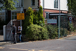 "© Licensed to London News Pictures. 19/07/2018. Salford, UK. Documentary TV crew by the school gates . Harrop Fold School in Little Hulton is closed for a protest by parents , objecting to the outcome of a months-long investigation in to record keeping which, it is alleged, revealed that data relating to pupils' performance was embellished and which has seen the school's popular headmaster suspended from duty. Parents planned a protest following the suspension of head master Drew Povey alongside three other members of staff . The school , which has been featured in the documentary "" Educating Greater Manchester "" will remain closed throughout the day . Photo credit: Joel Goodman/LNP"