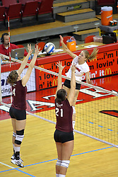 31 OCT 2008: M.C. Richmond strikes against a waiting Sara Staubach and Calli Norman during a match in which the Missouri State Bears defeated the Redbirds of Illinois State 3 sets to 2 on Doug Collins Court inside Redbird Arena in Normal Illinois
