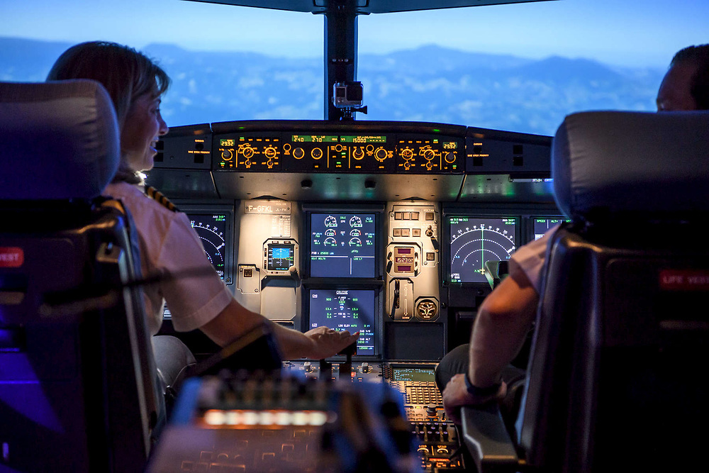 Image of pilots inside a cockpit simulator for a editorial story about aircraft air quality and pilot reaction times.