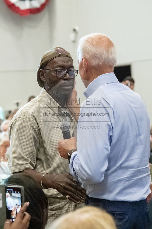 Former Vice President Joe Biden greets Tyrone Sanders, husband of Felicia Sanders, during a town hall meeting at the International Longshoreman's Association Hall July 7, 2019 in Charleston, South Carolina.  Felicia Sanders was a surviver of the Emanuel AME Church shooting in 2015 where nine of her fellow worshippers were murdered by a white supremacist.