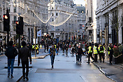 Scene of shoppers doing some last minute Christmas shopping along a pedestrianised Regent Street as the Prime Minister announces a new tighter fourth tier of local coronavirus restrictions for London and the South East, and that the planned Christmas relaxation of the rules was to be scrapped on 19th December 2020 in London, United Kingdom. These shoppers, mostly wearing face masks were unaware, as were shop owners that the new rules were about to be announced, and this would mean that all non-essential shops will have to close from midnight.