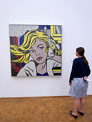 Woman looking at Painting M-Maybe ( A Girl's Picture) by Roy Lichtenstein  on display at Museum Ludwig in Cologne Germany
